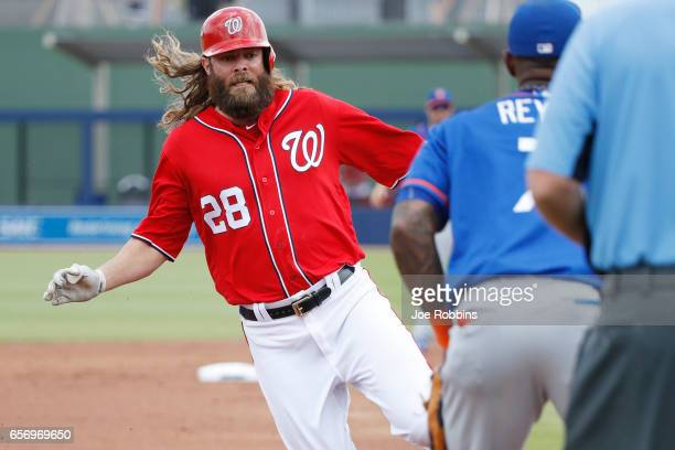 Jayson Werth of the Washington Nationals advances to third base on a hit by Bryce Harper in the first inning of a Grapefruit League spring training...