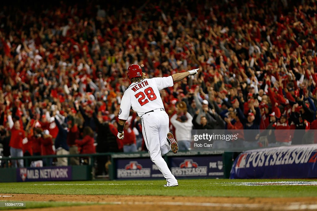 <a gi-track='captionPersonalityLinkClicked' href=/galleries/search?phrase=Jayson+Werth&family=editorial&specificpeople=206490 ng-click='$event.stopPropagation()'>Jayson Werth</a> #28 of the Washington Nationals celebrates as he run to first base on his solo game-winning walk-off home run in the bottom of the ninth inning against the St. Louis Cardinals during Game Four of the National League Division Series at Nationals Park on October 11, 2012 in Washington, DC.