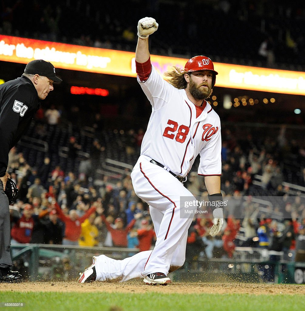 Jayson Werth #28 of the Washington Nationals celebrates scoring the winning run during the game against the Los Angeles Angels of Anaheim on April 23, 2014 at Nationals Park in Washington, DC.