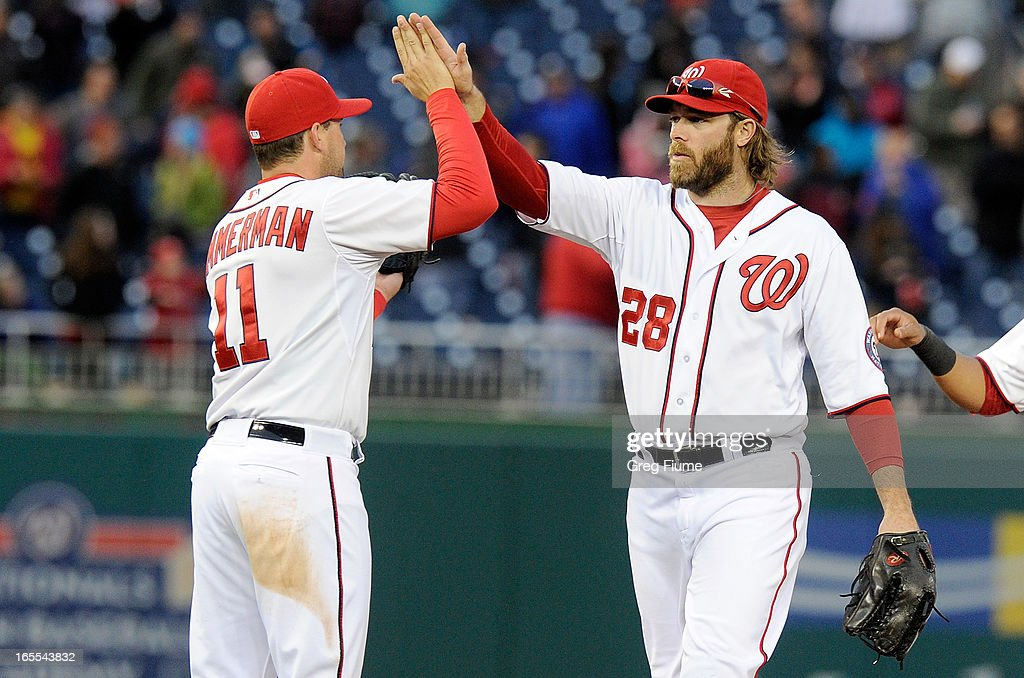 <a gi-track='captionPersonalityLinkClicked' href=/galleries/search?phrase=Jayson+Werth&family=editorial&specificpeople=206490 ng-click='$event.stopPropagation()'>Jayson Werth</a> #28 of the Washington Nationals celebrates with <a gi-track='captionPersonalityLinkClicked' href=/galleries/search?phrase=Ryan+Zimmerman+-+Jogador+de+basebol&family=editorial&specificpeople=534809 ng-click='$event.stopPropagation()'>Ryan Zimmerman</a> #11 after a 6-1 victory against the Miami Marlins at Nationals Park on April 4, 2013 in Washington, DC.