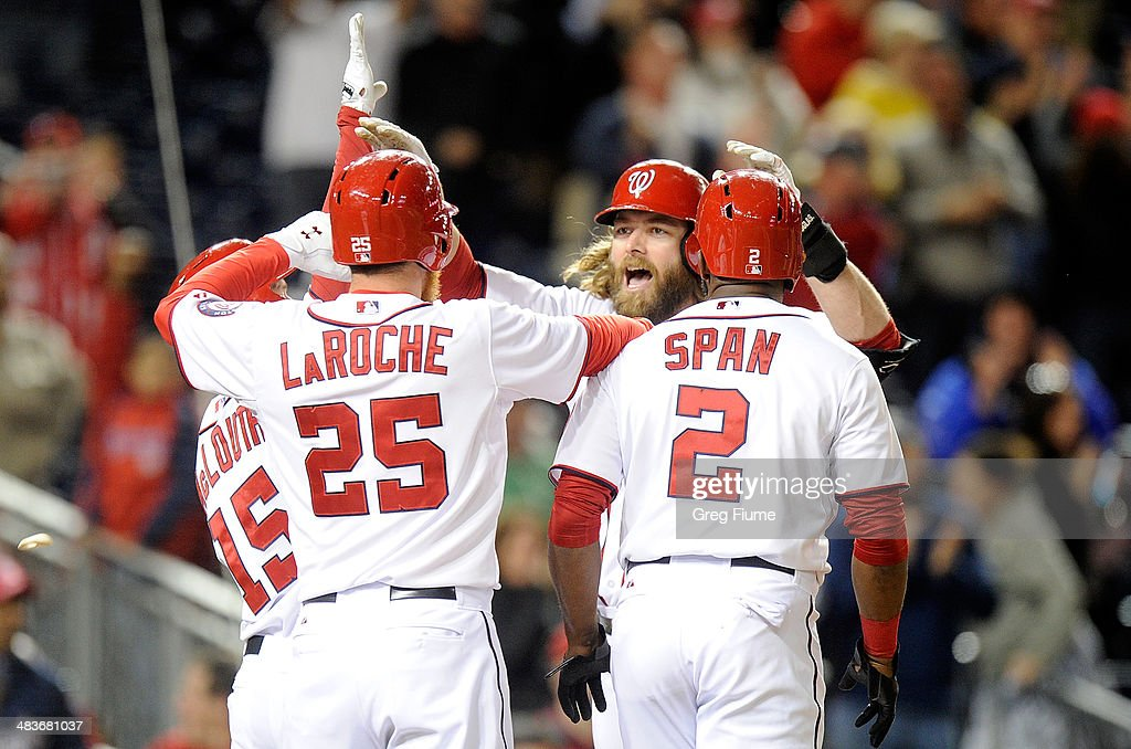 Jayson Werth #28 of the Washington Nationals celebrates with teammates after hitting a grand slam in the eighth inning against the Miami Marlins at Nationals Park on April 9, 2014 in Washington, DC. Washington won the game 10-7.