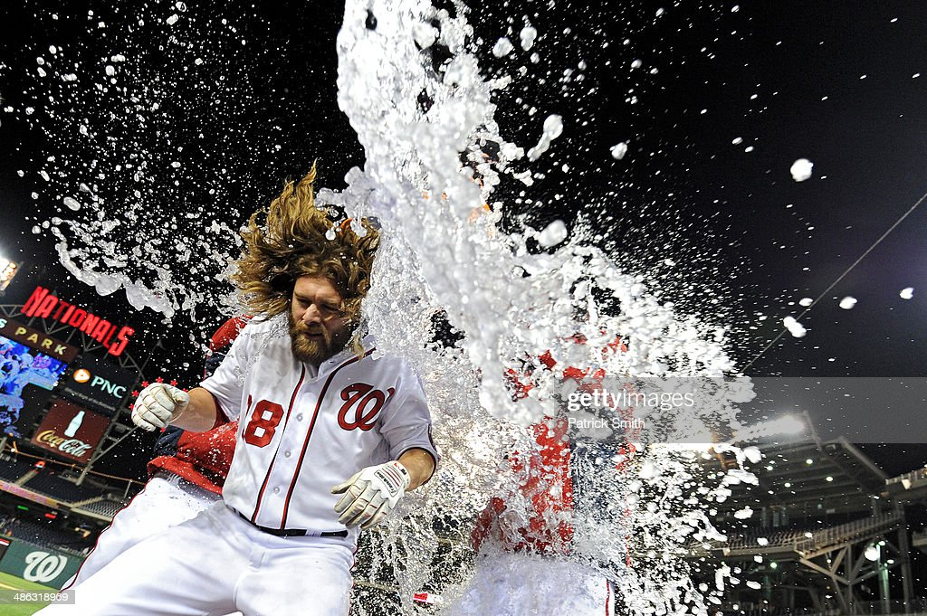 Jayson Werth #28 of the Washington Nationals is doused with water by teammates, after he hit an RBI double to score two runs to tie the game in the ninth inning, against the Los Angeles Angels of Anaheim at Nationals Park on April 23, 2014 in Washington, DC. The Washington Nationals won, 5-4.
