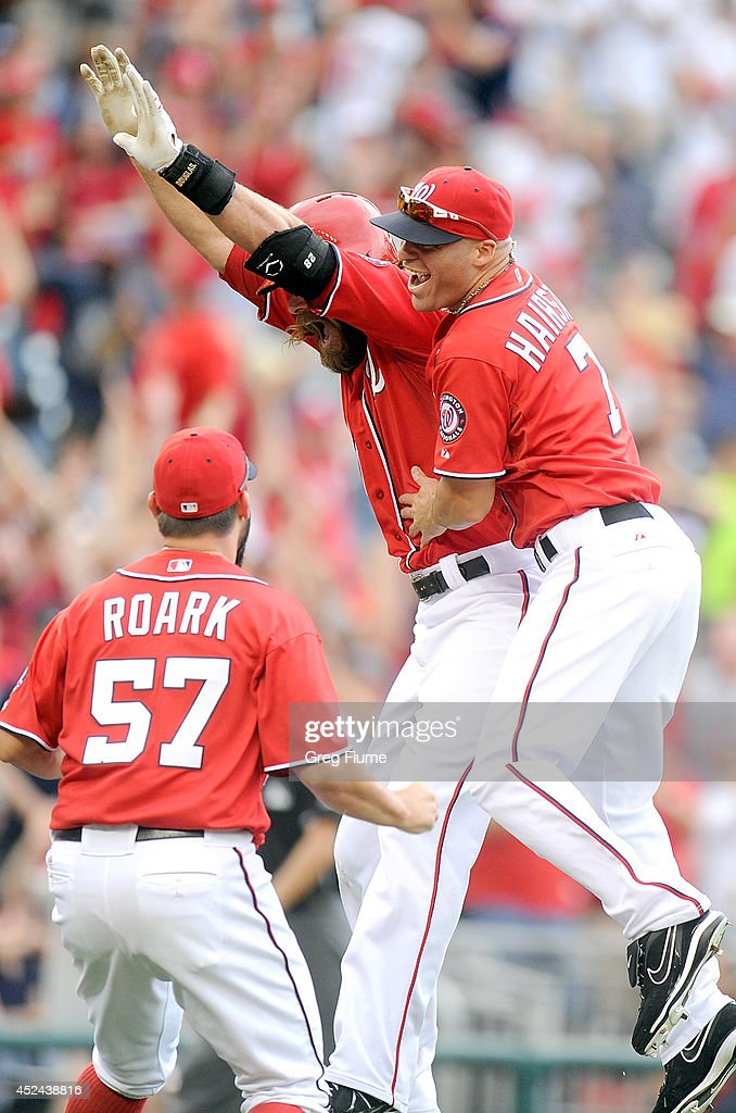 <a gi-track='captionPersonalityLinkClicked' href=/galleries/search?phrase=Jayson+Werth&family=editorial&specificpeople=206490 ng-click='$event.stopPropagation()'>Jayson Werth</a> #28 of the Washington Nationals is mobbed by teammates after driving in the game winning run in the ninth inning against the Milwaukee Brewers at Nationals Park on July 20, 2014 in Washington, DC. Washington won the game 5-4.