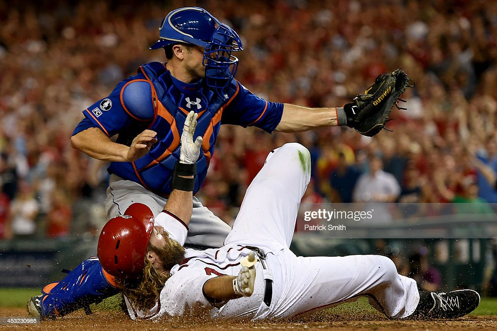 <a gi-track='captionPersonalityLinkClicked' href=/galleries/search?phrase=Jayson+Werth&family=editorial&specificpeople=206490 ng-click='$event.stopPropagation()'>Jayson Werth</a> #28 of the Washington Nationals is tagged out by catcher Travis d'Arnaud #15 of the New York Mets in the sixth inning at Nationals Park on August 5, 2014 in Washington, DC. The New York Mets won, 6-1.