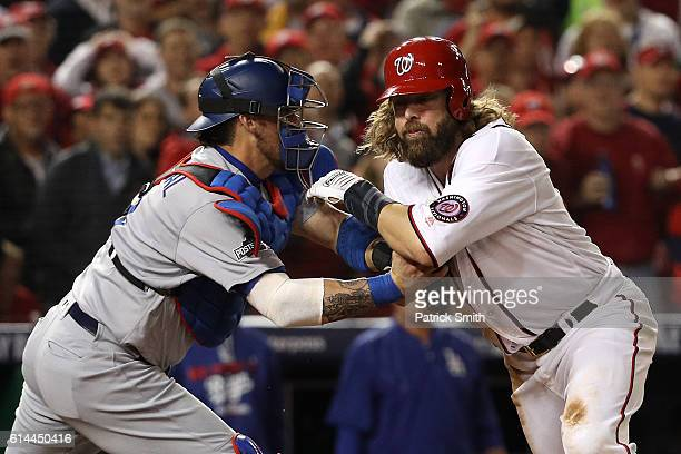Jayson Werth of the Washington Nationals is tagged out for the third out of the sixth inning by Yasmani Grandal of the Los Angeles Dodgers during...