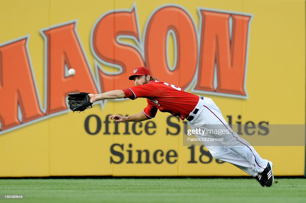 <a gi-track='captionPersonalityLinkClicked' href=/galleries/search?phrase=Jayson+Werth&family=editorial&specificpeople=206490 ng-click='$event.stopPropagation()'>Jayson Werth</a> #28 of the Washington Nationals leaps for a triple hit by Mike Baxter #23 of the New York Mets in the first inning at Nationals Park on August 18, 2012 in Washington, DC.