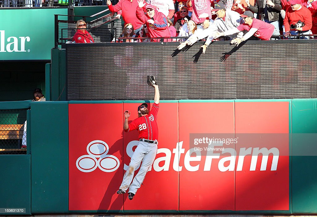 <a gi-track='captionPersonalityLinkClicked' href=/galleries/search?phrase=Jayson+Werth&family=editorial&specificpeople=206490 ng-click='$event.stopPropagation()'>Jayson Werth</a> #28 of the Washington Nationals makes a catch at the wall to save a home run in the sixth inning against the St Louis Cardinals during Game One of the National League Division Series at Busch Stadium on October 7, 2012 in St Louis, Missouri.