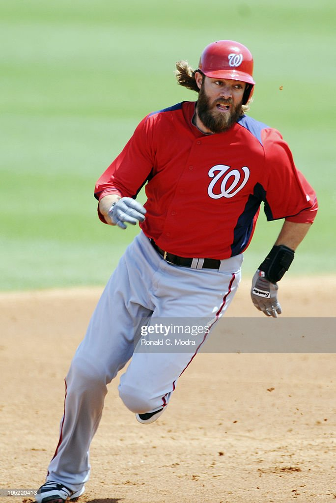 Jayson Werth #28 of the Washington Nationals runs to third base during a spring training game against the Miami Marlins at Roger Dean Stadium on March 26, 3012 in Jupiter, Florida.