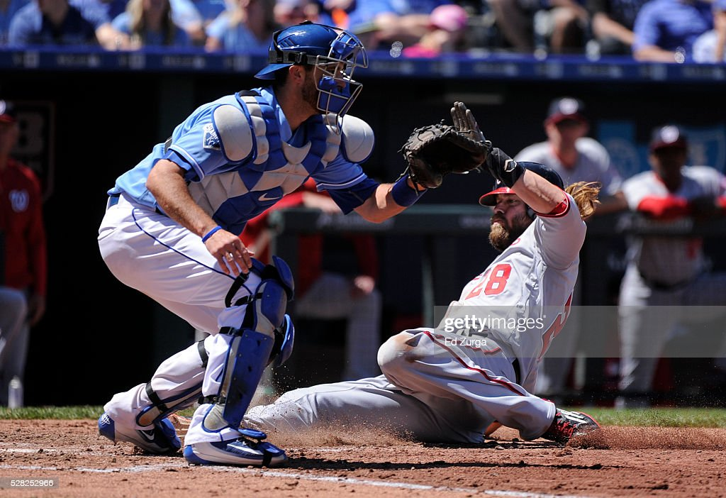 Jayson Werth #28 of the Washington Nationals scores past Drew Butera #9 of the Kansas City Royals on a Danny Espinosa sacrifice fly in the third inning at Kauffman Stadium on May 4, 2016 in Kansas City, Missouri.