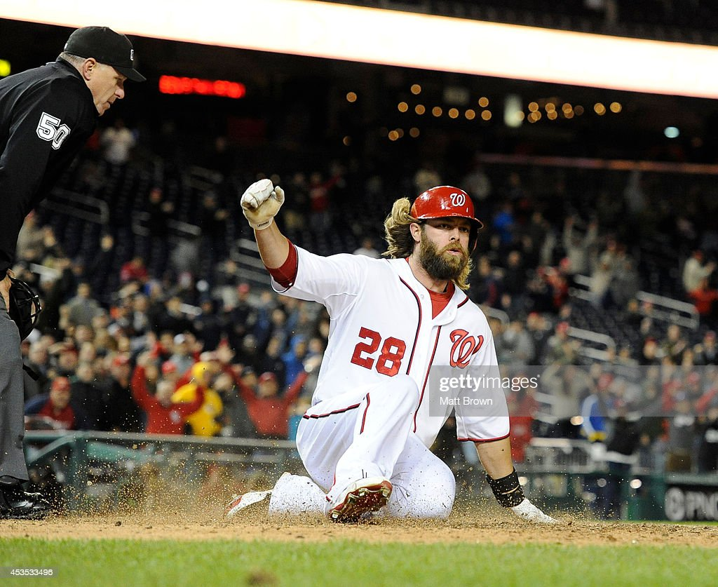 Jayson Werth #28 of the Washington Nationals slides into score the winning run during the game against the Los Angeles Angels of Anaheim on April 23, 2014 at Nationals Park in Washington, DC.
