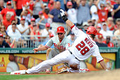 Jayson Werth of the Washington Nationals slides into third base for a triple in the third inning ahead of the tag by Kevin Frandsen of the...