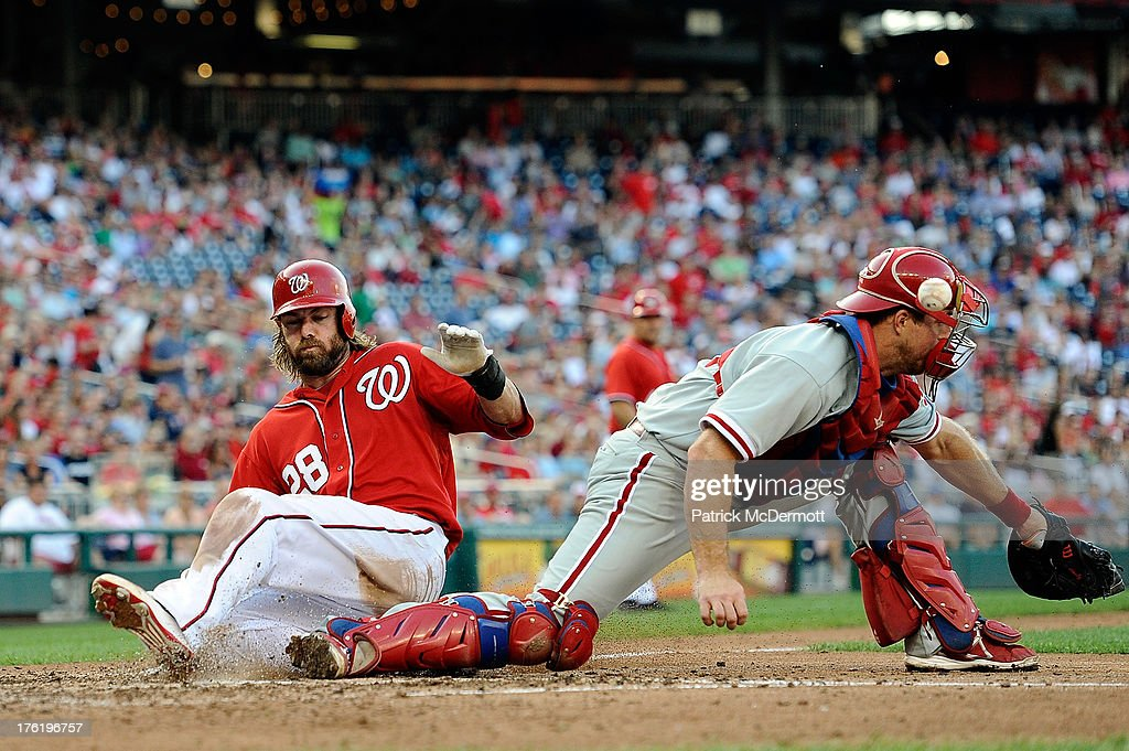 Jayson Werth #28 of the Washington Nationals slides safely into home plate past Erik Kratz #31 of the Philadelphia Phillies in the fifth inning during a game at Nationals Park on August 11, 2013 in Washington, DC.