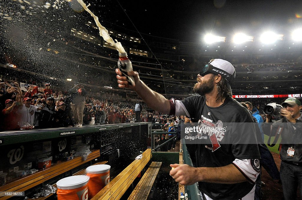 <a gi-track='captionPersonalityLinkClicked' href=/galleries/search?phrase=Jayson+Werth&family=editorial&specificpeople=206490 ng-click='$event.stopPropagation()'>Jayson Werth</a> #28 of the Washington Nationals sprays the crowd with beer after winning the National League East Division Championship after the game against the Philadelphia Phillies at Nationals Park on October 1, 2012 in Washington, DC.