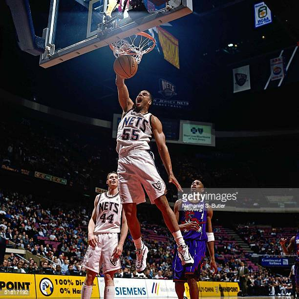 Jayson Williams of the New Jersey Nets dunks against the Toronto Raptors during the NBA game circa 1998 at the Continental Airlines Arena in East...