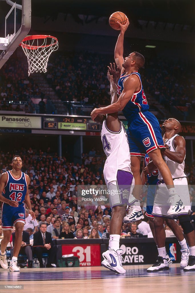 Jayson Williams #55 of the New Jersey Nets shoots the ball against the Sacramento Kings on November 23, 1994 at Arco Arena in Sacramento, California.