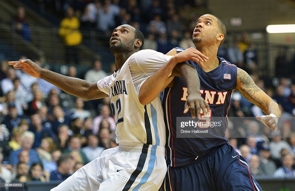 JayVaughn Pinkston #22 of the Villanova Wildcats and Henry Brooks #3 of the Pennsylvania Quakers battle for position at the Pavilion on December 4, 2013 in Villanova, Pennsylvania. Villanova won 77-54.