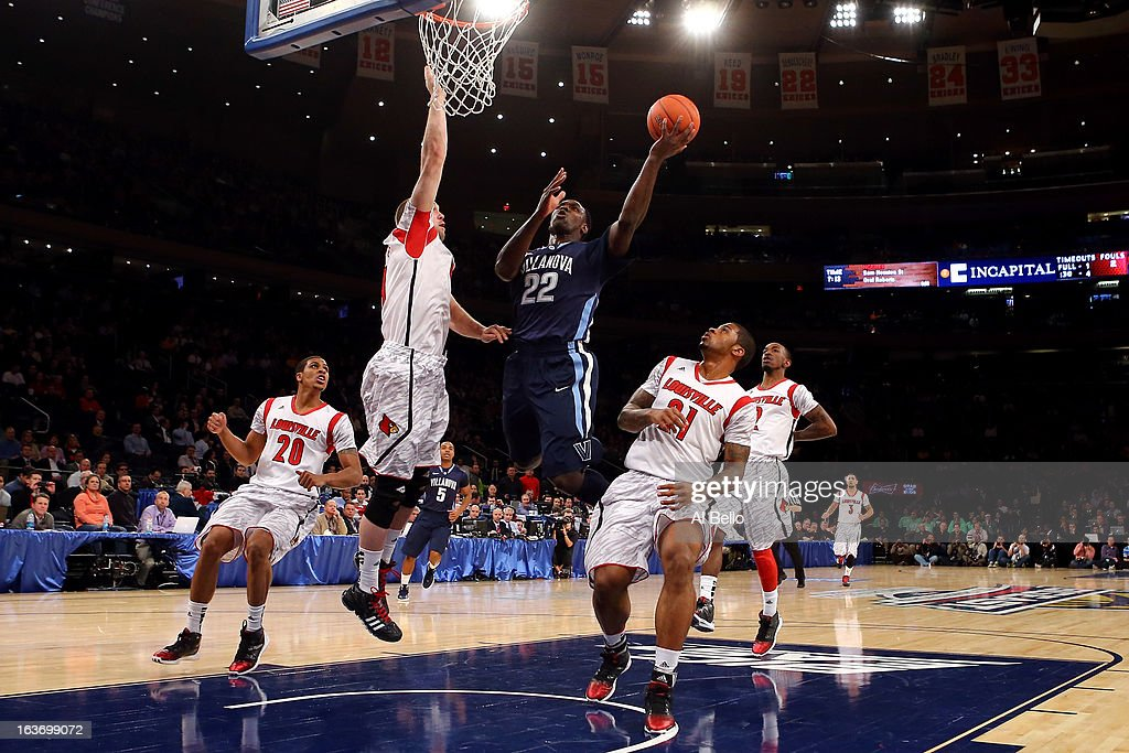 JayVaughn Pinkston #22 of the Villanova Wildcats drives for a shot attempt against Stephan Van Treese #44 of the Louisville Cardinals during the quaterfinals of the Big East Men's Basketball Tournament at Madison Square Garden on March 14, 2013 in New York City.