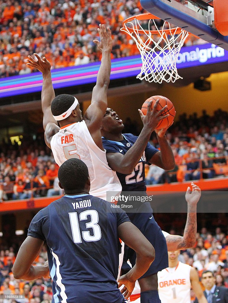 JayVaughn Pinkston #22 of the Villanova Wildcats puts the ball up to the basket as teamate Mouphtaou Yarou #13 against <a gi-track='captionPersonalityLinkClicked' href=/galleries/search?phrase=C.J.+Fair&family=editorial&specificpeople=7366451 ng-click='$event.stopPropagation()'>C.J. Fair</a> #5 of the Syracuse Orange during the game at the Carrier Dome on January 12, 2013 in Syracuse, New York.