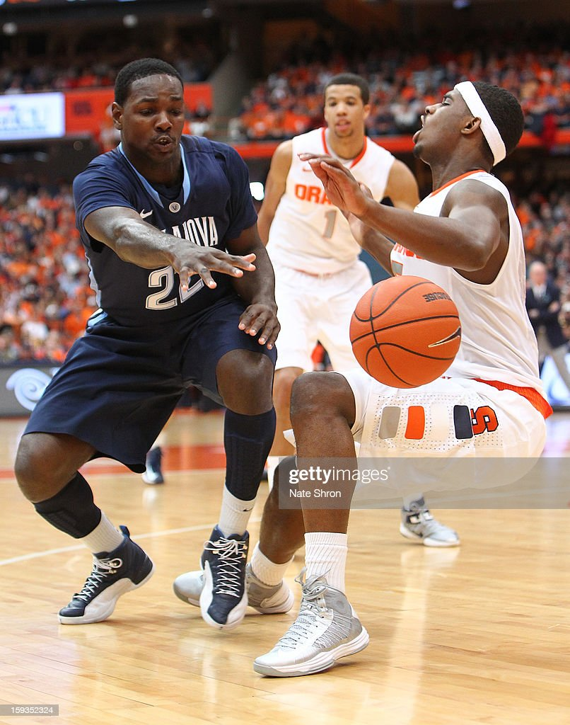 JayVaughn Pinkston #22 of the Villanova Wildcats reaches for the ball against <a gi-track='captionPersonalityLinkClicked' href=/galleries/search?phrase=C.J.+Fair&family=editorial&specificpeople=7366451 ng-click='$event.stopPropagation()'>C.J. Fair</a> #5 of the Syracuse Orange during the game at the Carrier Dome on January 12, 2013 in Syracuse, New York.