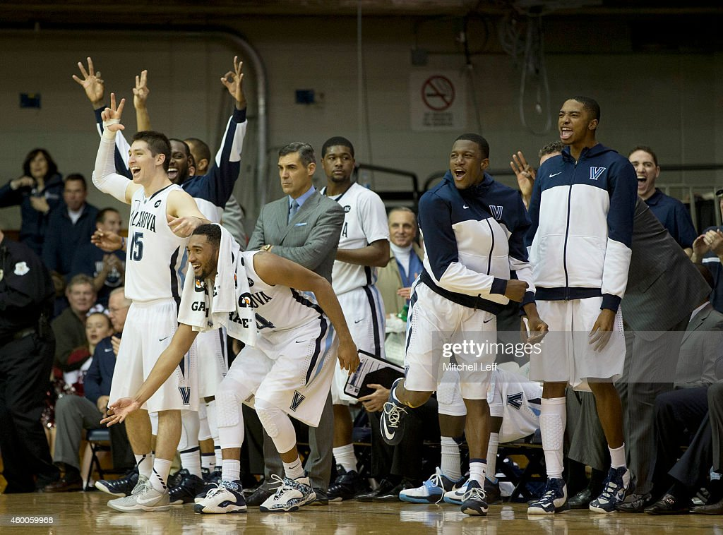 JayVaughn Pinkston #22, <a gi-track='captionPersonalityLinkClicked' href=/galleries/search?phrase=Ryan+Arcidiacono&family=editorial&specificpeople=7887112 ng-click='$event.stopPropagation()'>Ryan Arcidiacono</a> #15, <a gi-track='captionPersonalityLinkClicked' href=/galleries/search?phrase=Darrun+Hilliard&family=editorial&specificpeople=8710176 ng-click='$event.stopPropagation()'>Darrun Hilliard</a> #4, Kris Jenkins #2, Dylan Ennis #31, <a gi-track='captionPersonalityLinkClicked' href=/galleries/search?phrase=Mikal+Bridges&family=editorial&specificpeople=13740714 ng-click='$event.stopPropagation()'>Mikal Bridges</a> #25 and head coach <a gi-track='captionPersonalityLinkClicked' href=/galleries/search?phrase=Jay+Wright&family=editorial&specificpeople=226981 ng-click='$event.stopPropagation()'>Jay Wright</a> of the Villanova Wildcats react after a made basket in the final minutes of the game against the Saint Joseph's Hawks on December 6, 2014 at the Pavilion in Villanova, Pennsylvania. The Wildcats defeated the Hawks 74-46