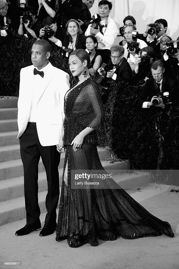 <a gi-track='captionPersonalityLinkClicked' href=/galleries/search?phrase=Jay-Z&family=editorial&specificpeople=201664 ng-click='$event.stopPropagation()'>Jay-Z</a> (L) and Beyonce attend the 'Charles James: Beyond Fashion' Costume Institute Gala at the Metropolitan Museum of Art on May 5, 2014 in New York City.