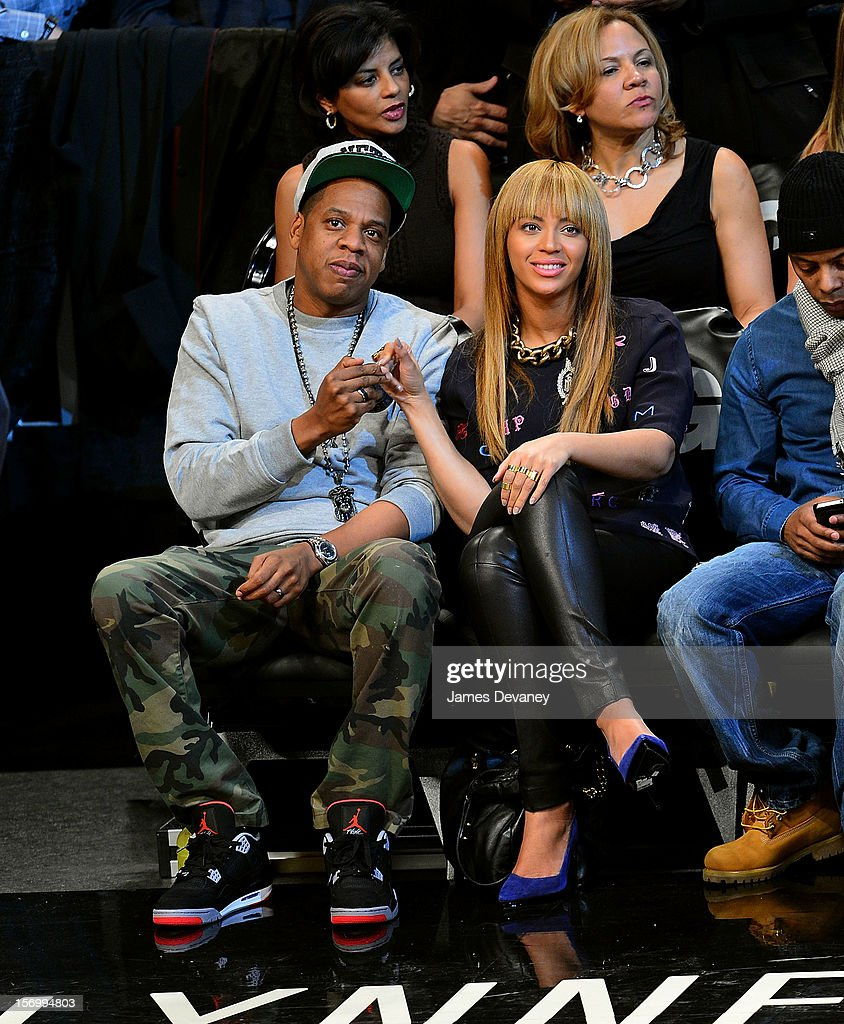 <a gi-track='captionPersonalityLinkClicked' href=/galleries/search?phrase=Jay-Z&family=editorial&specificpeople=201664 ng-click='$event.stopPropagation()'>Jay-Z</a> and <a gi-track='captionPersonalityLinkClicked' href=/galleries/search?phrase=Beyonce+Knowles&family=editorial&specificpeople=171204 ng-click='$event.stopPropagation()'>Beyonce Knowles</a> attend the New York Knicks vs Brooklyn Nets game at Barclays Center on November 26, 2012 in the Brooklyn borough of New York City.