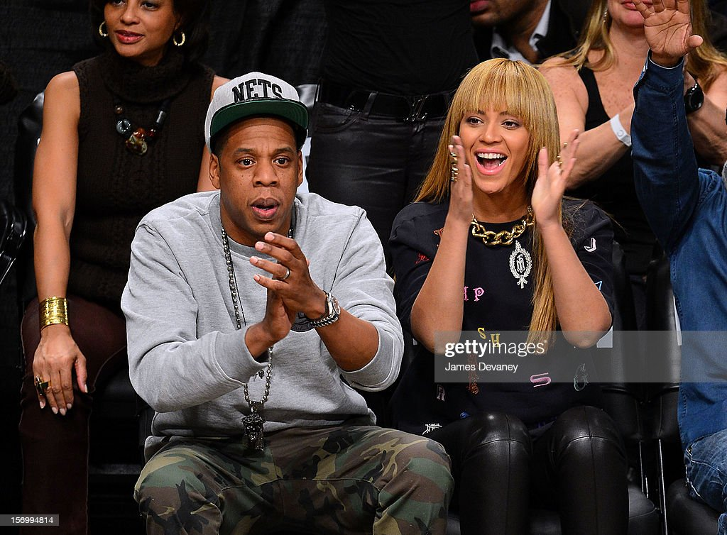 Jay-Z and Beyonce Knowles attend the New York Knicks vs Brooklyn Nets game at Barclays Center on November 26, 2012 in the Brooklyn borough of New York City.