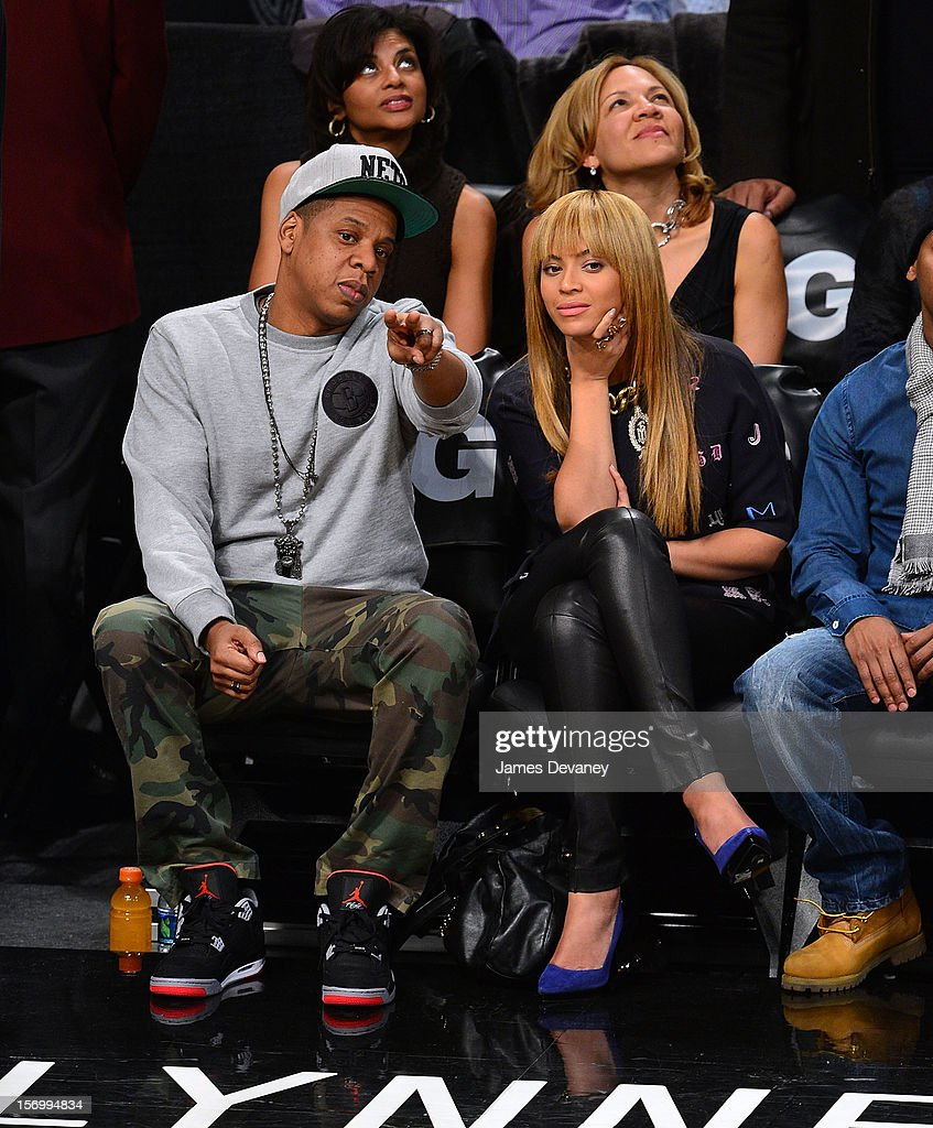 <a gi-track='captionPersonalityLinkClicked' href=/galleries/search?phrase=Jay-Z&family=editorial&specificpeople=201664 ng-click='$event.stopPropagation()'>Jay-Z</a> and Beyonce Knowles attend the New York Knicks vs Brooklyn Nets game at Barclays Center on November 26, 2012 in the Brooklyn borough of New York City.