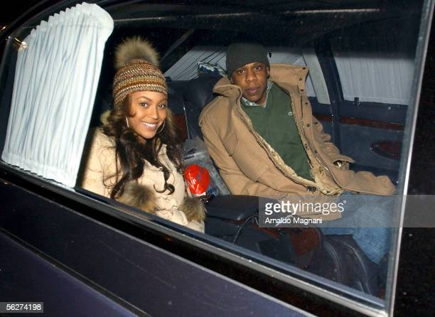 JayZ and Beyonce Knowles smile from a car after dining in a midtown restaurant on November 25 2005 in New York City