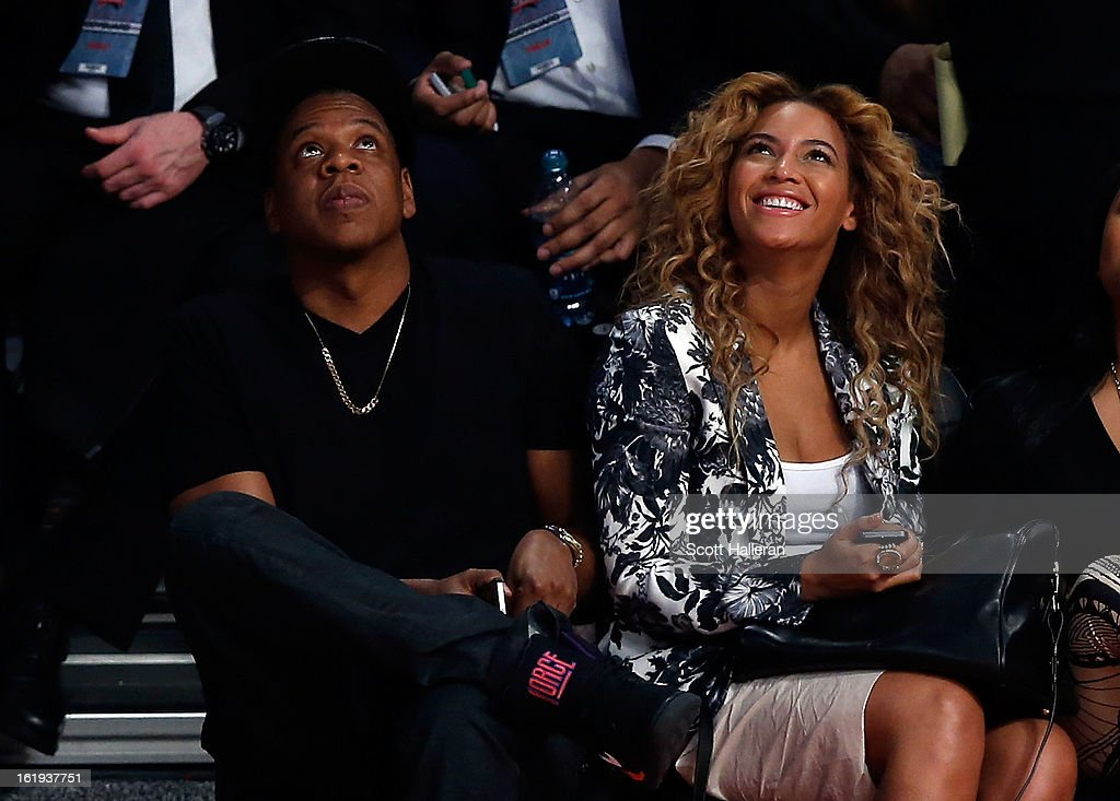 Jay-Z and Beyonce look up at the video screen during the 2013 NBA All-Star game at the Toyota Center on February 17, 2013 in Houston, Texas.
