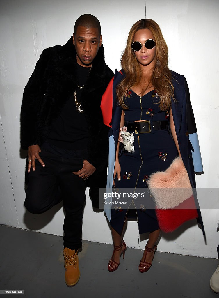 Jay-Z (L) and Beyonce pose backstage at the adidas Originals x Kanye West YEEZY SEASON 1 fashion show during New York Fashion Week Fall 2015 at Skylight Clarkson Sq on February 12, 2015 in New York City.
