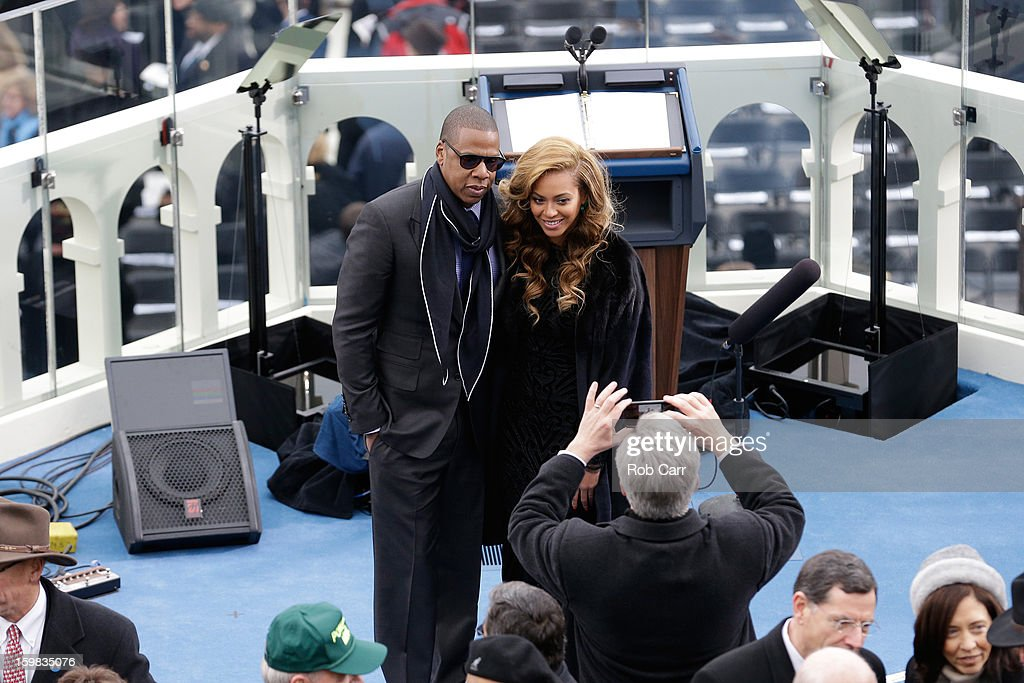 Jay-Z and Beyonce pose for a photo after the public ceremonial inauguration for U.S. President Barack Obama on the West Front of the U.S. Capitol January 21, 2013 in Washington, DC. Barack Obama was re-elected for a second term as President of the United States.