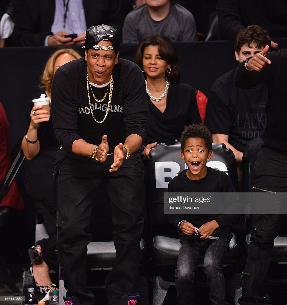 Jay-Z and guest attend the Chicago Bulls Vs Brooklyn Nets Playoff Game at the Barclays Center on April 20, 2013 in the Brooklyn borough of New York City.