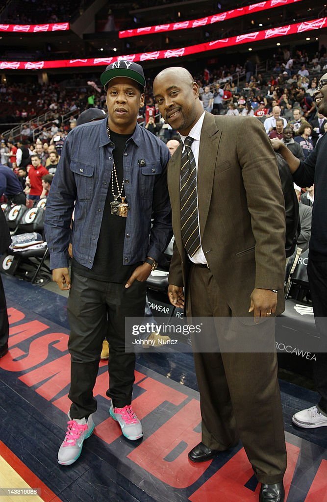 Jay-Z and Kenny Anderson attend the New Jersey Nets end of season game at the Prudential Center on April 23, 2012 in Newark City.