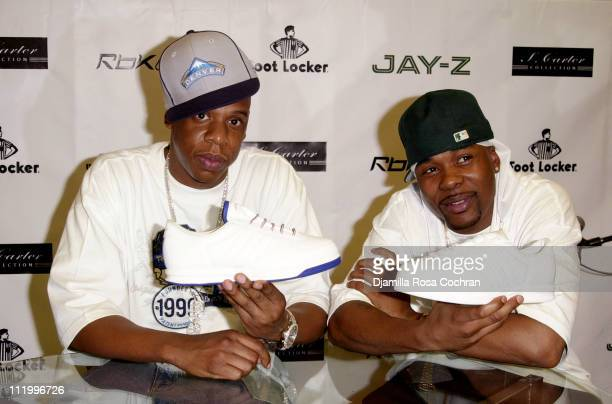JayZ and Memphis Bleek during Jay Z Brings S Carter Shoe Collection Home to New York City at Foot Locker in New York City New York United States