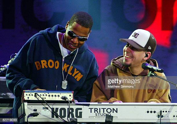 JayZ and Mike Shinoda of Linkin Park perform during the 'Music for Relief' tsunami benefit concert at the Anaheim Pond on February 18 2005 in Anaheim...