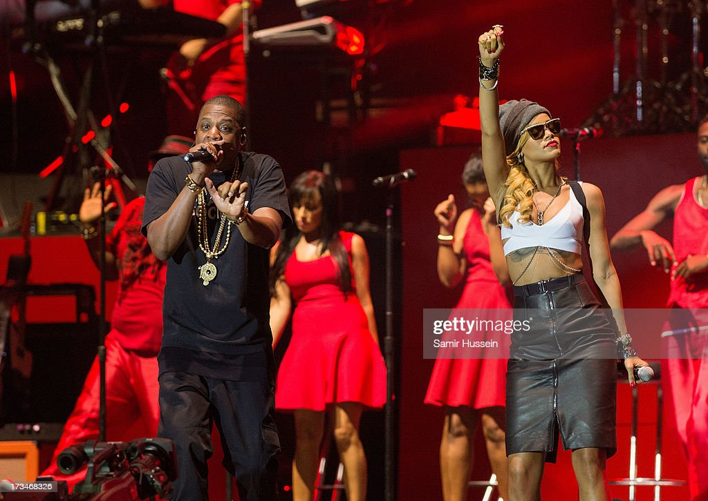 <a gi-track='captionPersonalityLinkClicked' href=/galleries/search?phrase=Jay-Z&family=editorial&specificpeople=201664 ng-click='$event.stopPropagation()'>Jay-Z</a> and <a gi-track='captionPersonalityLinkClicked' href=/galleries/search?phrase=Rihanna&family=editorial&specificpeople=453439 ng-click='$event.stopPropagation()'>Rihanna</a> perform on the main stage on day 3 of the Yahoo! Wireless Festival at Queen Elizabeth Olympic Park on July 14, 2013 in London, England.