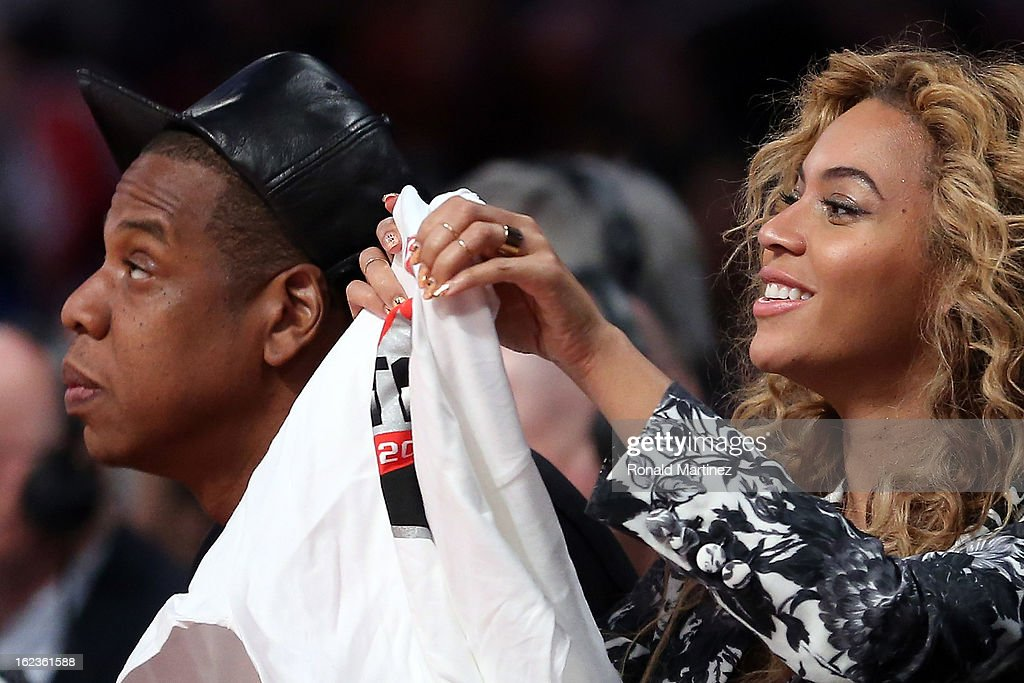 Jay-Z and wife Beyonce look on during the 2013 NBA All-Star game at the Toyota Center on February 17, 2013 in Houston, Texas.
