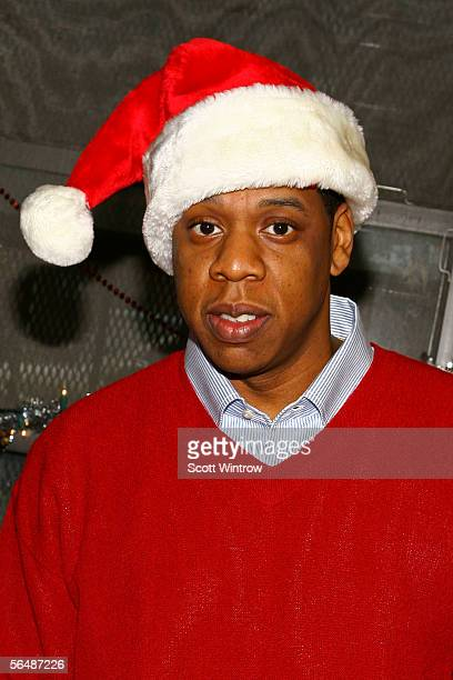 JayZ gives Christmas gifts to children in his old neighborhood of BedfordStuyvesant on December 25 2005 in the Brooklyn borough of New York