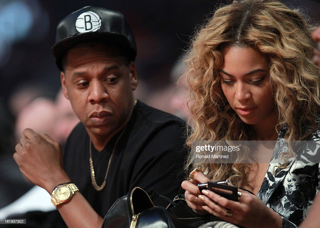 Jay-Z looks over at wife Beyonce during the 2013 NBA All-Star game at the Toyota Center on February 17, 2013 in Houston, Texas.