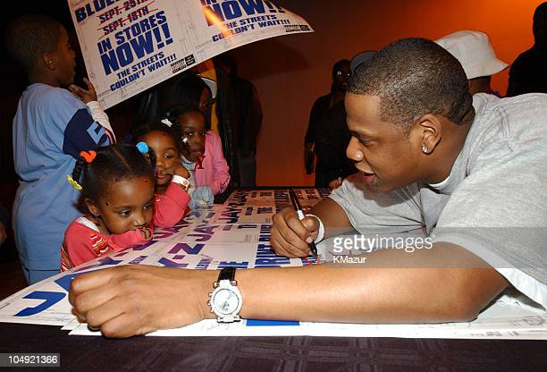 JayZ with Team Roc kids during Benefit Concert for Team Roc at the Apollo Theatre at Apollo Theatre in New York City New York United States