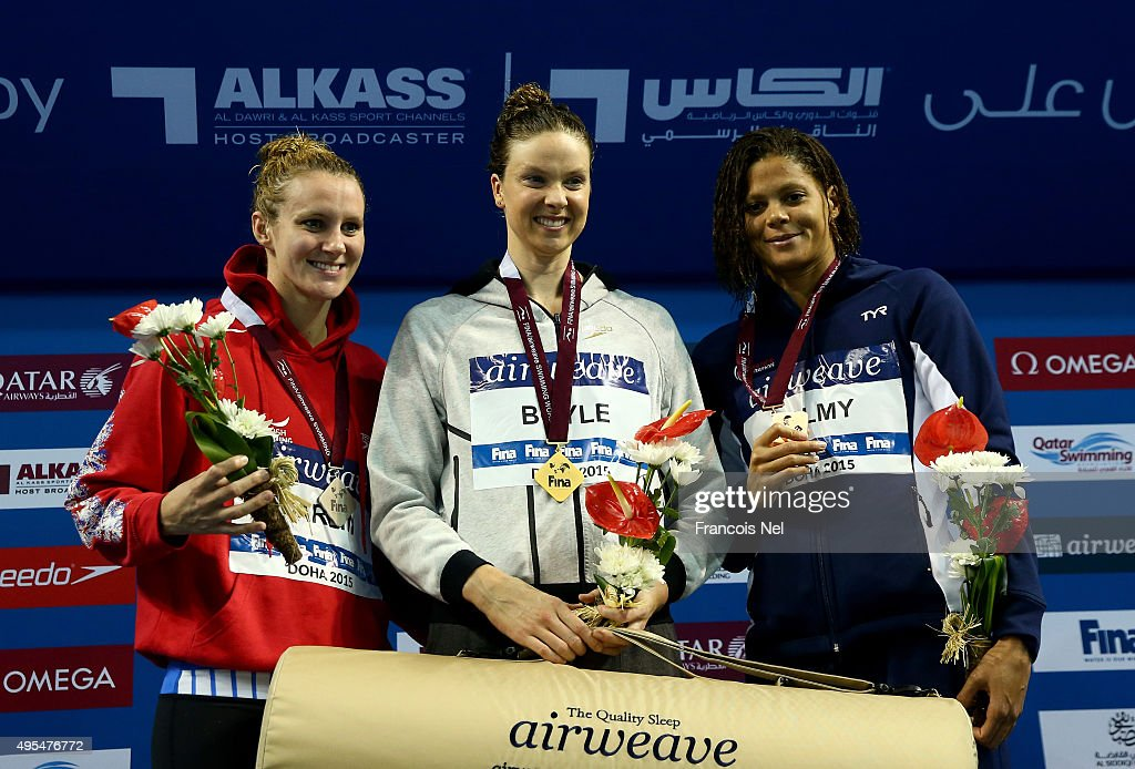 Jaz Carlin of Great Britain Lauren Boyle of New Zealand and Coralie Balmy of France celebrates on the podium after the Women's 400m Freestyle final...