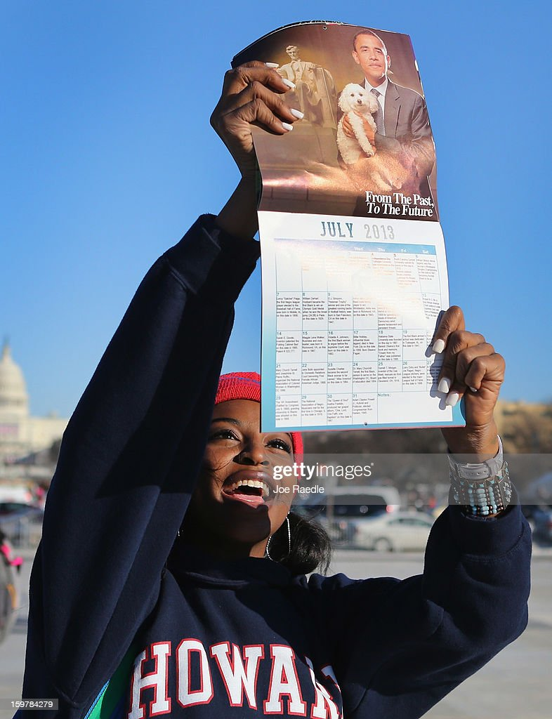 Jazelle Merritt holds up a souvenir U.S. President Barack Obama calendar she is selling on the National Mall on January 20, 2013 in Washington, DC. The US capital is preparing for the second inauguration of U.S. President Barack Obama, which will take place on January 21.