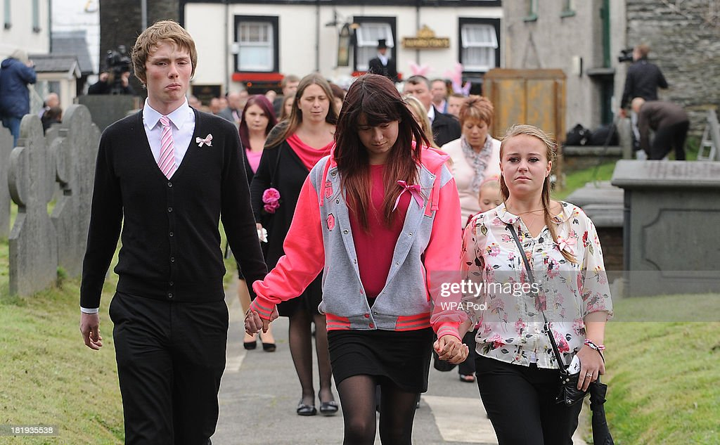 Jazmin Jones (C), sister of April, arrives ahead of the funeral service for murdered schoolgirl April Jones at St Peter's Church on September 26, 2013 in Machynlleth, Wales. Local man Mark Bridger, aged 47, was found guilty of abducting and murdering five-year-old April who went missing in Machynleth on October 1, 2012.