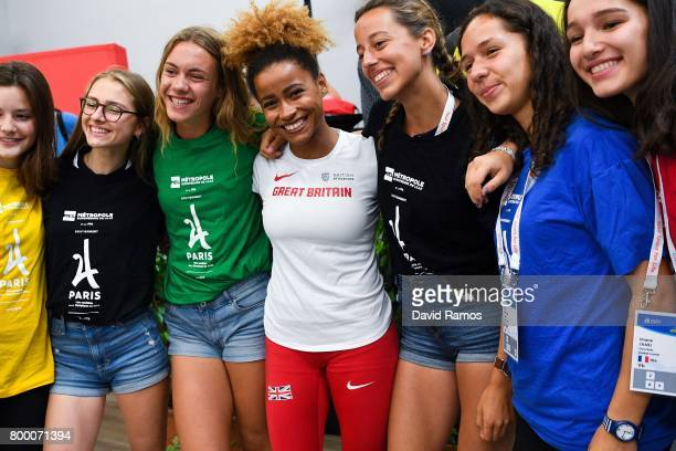 Jazmin Sawyers of Great Britain poses with volunteers during a press conference ahead of the European Athletics Team Championships at the Lille...