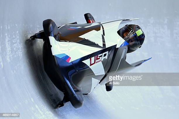 Jazmine Fenlator of the United States pilots a run during a Women's Bobsleigh training session on day 7 of the Sochi 2014 Winter Olympics at the...