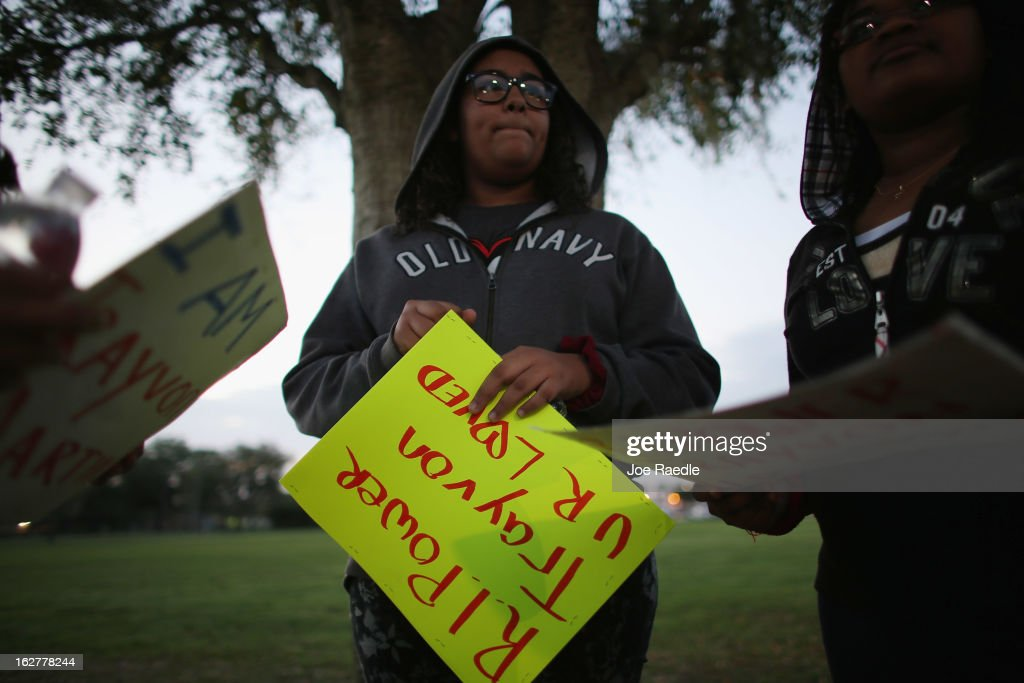 Jazmyn Soto wears a hoodie as she attends a vigil at Fort Mellon Park to mark the one year anniversary of when Trayvon Martin was killed on February 26, 2013 in Sanford, Florida. Martin was shot by George Zimmerman on February 26, 2012 while Zimmerman was on neighborhood watch patrol in the gated community of The Retreat at Twin Lakes in Sanford, Florida.