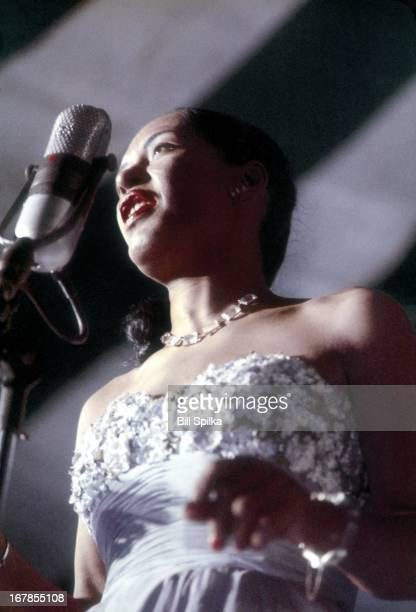 Jazz and blues singer Billie Holiday performs at the Newport Jaszz festival on July 6 1957 in Newport Rhode Island