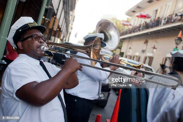 A jazz band playing in a second line for a wedding in true New Orleans style around the French Quarter New Orleans Louisiana USA