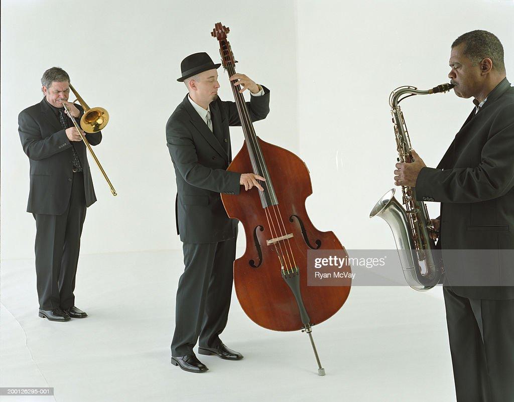 Jazz band playing saxophone, trombone, and bass